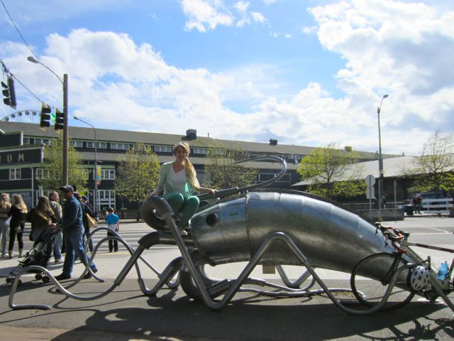 Not only am I smiling, but I'm smiling and sitting on a squid!